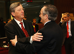 BRUSSELS, BELGIUM - MARCH-08-2005 - Jean-Claude Juncker, Luxembourg's prime minister, left, greets a colleague during the ECOFIN conference, a meeting of  European Union finance and economic ministers, in Brussels.