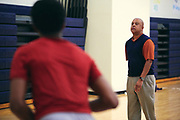 Tyrous Ingram rebounds for his son, Harrison Ingram, after basketball practice at St. Mark's School of Texas in Dallas, Texas on December 6, 2017. (Cooper Neill for The Undefeated)