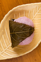Japanese Mochi is a rice cake made of  rice pounded into paste and then molded into shape - in this case covered with a leaf for freshness. Many types of Japanese traditional sweets are made with mochi: daifuku is a soft round mochi stuffed with sweet filling such as bean paste.