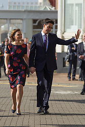 © Licensed to London News Pictures . 24/09/2013 . Brighton , UK . The Labour Party Leader , Ed Miliband , walks with his wife , Justine Thornton , from The Grand Hotel to the conference centre ahead of delivering the Leader's Speech to the conference , this afternoon (24th September 2013) . Day 3 of the Labour Party Conference in Brighton . Photo credit : Joel Goodman/LNP