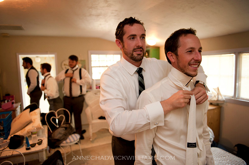 A groom gets help with his tie before his wedding at the Emmanuel Church in Coloma, California.  Reception followed at the Coloma Country Inn on.