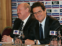 Photo: Tom Dulat/Sportsbeat Images.<br /> <br /> England Press Conference. 17/12/2007.<br /> <br /> Fabio Capello (R) answers questions during press conference. In the picture together with Brian Barwick (L)