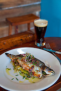 Ned Ludd, a restaurant in NE Portland, where nearly every dish is cooked in the restaurant's wood burning oven. Ruby trout with fennel, leeks, lemon, herbs and olive oil served with Terminal Gravity's Breakfast Porter beer.