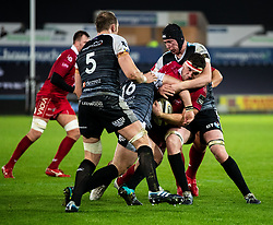 Lewis Rawlins of Scarlets under pressure from Adam Beard of Ospreys<br /> <br /> Photographer Simon King/Replay Images<br /> <br /> Guinness PRO14 Round 11 - Ospreys v Scarlets - Saturday 22nd December 2018 - Liberty Stadium - Swansea<br /> <br /> World Copyright © Replay Images . All rights reserved. info@replayimages.co.uk - http://replayimages.co.uk