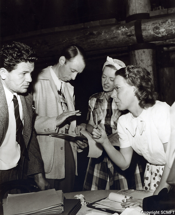 1942 Planning the Hollywood Canteen are John Garfield, Unknown, Bette Davis and Jean Lewin