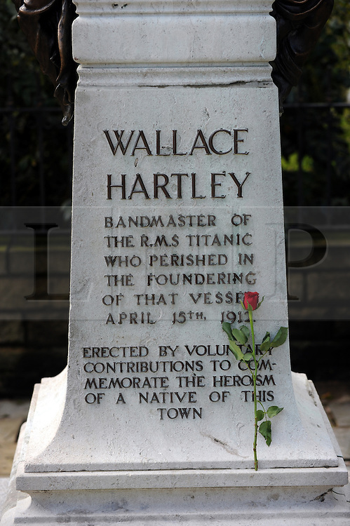 Licensed to London News Pictures 12/04/2012..Colne, Lancashire, UK Tributes to Titanic bandleader Wallace Hartley are placed on his statue in Colne town centre, Colne, Lancashire as the centenary to the famous ships sinking approaches...He became famous for leading the eight member band playing  Nearer, My God, to Thee as the ship sank on 15 April 1912. His body was recovered and 40000 people attended his funeral. His violin has possibly been found recently and tests by a Wiltshire auction house will determine if it really is his. It could be worth £1m if it is...Photo Credit Julian Brown/LNP..