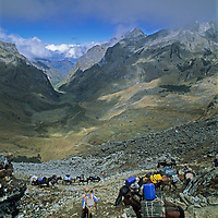 A pack train for a National Geographic archaeology expedition crosses Choquetecarpo Pass (5100+ meters) in Peru's Cordillera Vilcabamba mountains, en route to Cerro Victoria at the end of the canyon (Quebrada Moyoc).