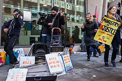 London, UK. 22nd January, 2019. Two Bulgarian musicians entertain receptionists, security guards and cleaners from the Ministry of Justice (MoJ) represented by the United Voices of the World (UVW) trade union on the picket line after beginning a strike for the London Living Wage of £10.55 per hour and parity of sick pay and annual leave allowance with civil servants. The strike is being coordinated with support staff at the Department for Business, Energy and Industrial Strategy (BEIS) from the Public and Commercial Services (PCS) union.