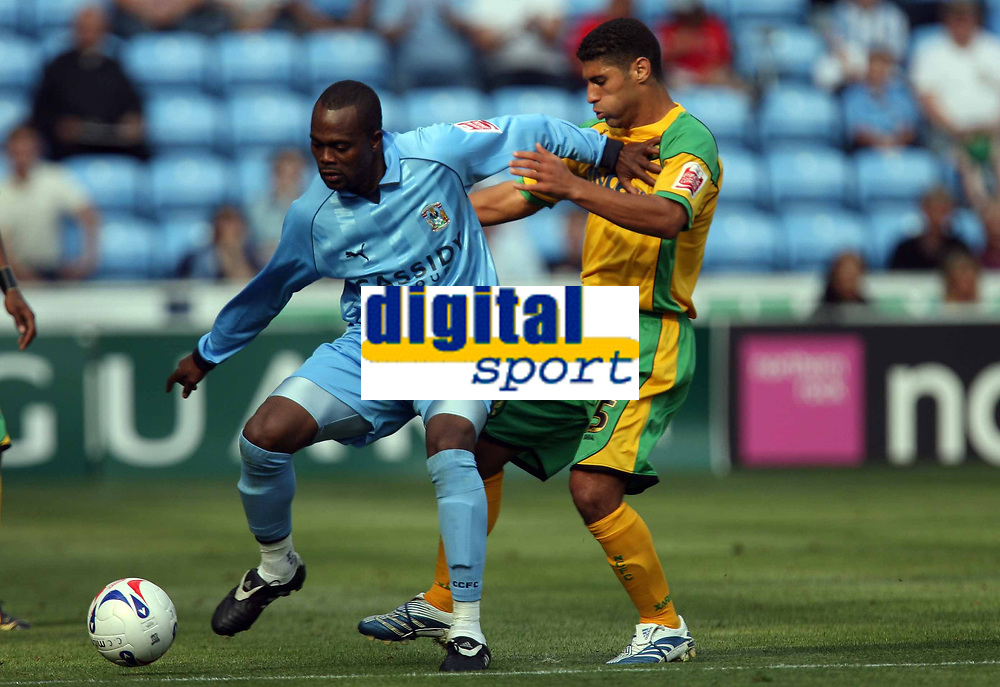 Photo: Rich Eaton.<br /> <br /> Coventry City v Norwich City. Coca Cola Championship. 09/09/2006. Coventry goalscorer left Stern John keeps the ball away from Norwichs Youssef Safri