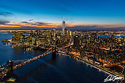 Aerial view of lower Manhattan, New York City, at dusk, showing the Brooklyn Bridge, photographed from a helicopter.