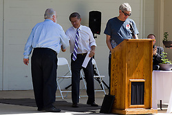 10 May 2014:  Bloomington Mayor Tari Renner shakes hand of Garrett Scott for 25th anniversary celebration of the Constitution Trail ceremony at Connie Link Amphitheater in Normal Illinois