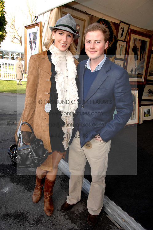 GUY PELLY and SUSANNA WARREN at the 2007 Hennessy Gold Cup held at Newbury racecourse, Berkshire on 1st December 2007.<br />