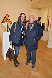 DAVID BAILEY and his wife CATHERINE at the opening private view of 'A Strong Sweet Smell of Incense - A portrait of Robert Fraser, held at the Pace Gallery, Burlington Gardens, London on 5th February 2015.