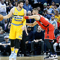 18 November 2016: Denver Nuggets center Jusuf Nurkic (23) posts up Toronto Raptors center Jonas Valanciunas (17) during the Toronto Raptors 113-111 OT victory over the Denver Nuggets, at the Pepsi Center, Denver, Colorado, USA.