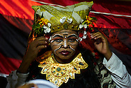Balinese Legong dancer waits backstage in costume before a show, Bali, Indonesia, Southeast Asia