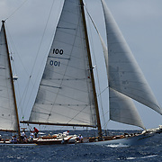 Back in the 60s, classic yachts in English Harbour had begun chartering and the captains and crews challenged each other to a race down to Guadeloupe at the end of the charter season. From this informal race, Antigua Sailing Week was formed in 1967, and in those days all of the yachts were classic. However, over the next 24 years, the classic yachts were slowly outnumbered by the faster, sleeker modern racing yachts. A small number of classics still racing in 1987 found themselves grouped with cruising Class 3 which was less than ideal for these hard to manoeuvre full-keeled vessels. And so it came about that Captains Uli Pruesse and Kenny Coombs hosted a meeting with other classic skippers onboard the magnificent schooner Aschanti of Saba and, several rums later, the Antigua Classic Yacht Regatta was born.
