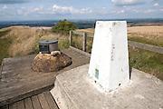 White triangulation pillar standing on a hilltop inside Liddington Castle hill fort, Wiltshire, England