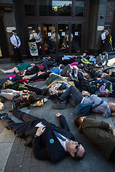 London, UK. 14 May, 2019. Climate change activists from Extinction Rebellion stage a die-in outside Harrods as part of a protest against fast and unsustainable fashion. A small number of activists also succeeded in holding a die-in inside the department store in spite of additional security checks at all entrances.
