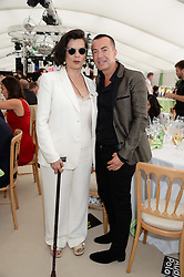 BIANCA JAGGER and JULIEN MACDONALD at the Boujis hospitality at the Audi International Polo at Guards Polo Windsor Great Park, Egham, Surrey on 28th July 2013.