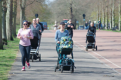 © Licensed to London News Pictures 13/04/2021. Greenwich, UK. Mothers doing a group fitness class. People enjoying the sunny weather and exercising in Greenwich Park, London as coronavirus lockdown restrictions continue to ease in the UK. Photo credit:Grant Falvey/LNP