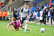 Bolton Wanderers midfielder Thibaud Verlinden challenged by Rochdale defender Rhys Norrington-Davies during the EFL Sky Bet League 1 match between Bolton Wanderers and Rochdale at the University of  Bolton Stadium, Bolton, England on 19 October 2019.