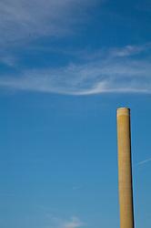 industrial chymney against blue sky