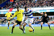 Queens Park Rangers midfielder Pawel Wszolek (15) battles for possesion with Burton Albion midfielder Luke Murphy (30) during the EFL Sky Bet Championship match between Queens Park Rangers and Burton Albion at the Loftus Road Stadium, London, England on 28 January 2017. Photo by Matthew Redman.