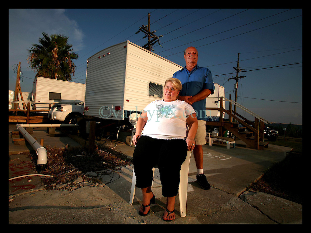 17 August 2006 - Slidell - Louisiana. Linda Spears (58 yrs) and her husband Charles (65 yrs) struggle in the cramped conditions of their FEMA trailer located on the site of their former home at 180a, Lakeview Drive. Hurricane Katrina wiped out the Spears' house, taking everything they owned. They are currently taking legal action against State Farm insurance company who have paid them a paltry $3,000 instead of settling with them for the insured value of their home and contents which total in excess of $230,000.<br />Photo credit; Charlie Varley/varleypix.com