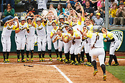 The Oregon Ducks welcome Oregon outfielder Koral Costa (7) at home plate after Costa hit a home run during the fourth inning. The Oregon Ducks play the Oregon State Beavers at Howe Field in Eugene, Oregon on March 13, 2015. (Ryan Kang/Emerald)