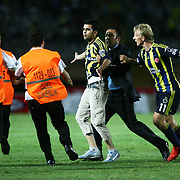 Security persons are running to the Fenerbahce's supporter for prevent him during their Turkish superleague soccer match S.B. Elazigspor between Fenerbahce at the Ataturk stadium in izmir Turkey on Saturday 18 August 2012. Photo by TURKPIX