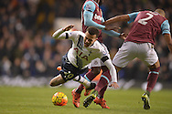 Winston Reid of West Ham United fouls Dele Alli of Tottenham Hotspur. Barclays Premier league match, Tottenham Hotspur v West Ham Utd at White Hart Lane in London on Sunday 22nd November 2015.<br /> pic by John Patrick Fletcher, Andrew Orchard sports photography.