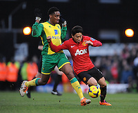 Norwich City's Leroy Fer (left) and Manchester United's Shinji Kagawa (right) battle for the ball.