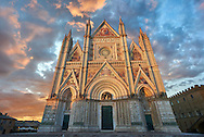 Sunset picture of the 14th century Tuscan Gothic style facade of the Cathedral of Orvieto, designed by Maitani, Umbria, Italy .<br /> <br /> Visit our ITALY HISTORIC PLACES PHOTO COLLECTION for more   photos of Italy to download or buy as prints https://funkystock.photoshelter.com/gallery-collection/2b-Pictures-Images-of-Italy-Photos-of-Italian-Historic-Landmark-Sites/C0000qxA2zGFjd_k<br /> .<br /> <br /> Visit our MEDIEVAL PHOTO COLLECTIONS for more   photos  to download or buy as prints https://funkystock.photoshelter.com/gallery-collection/Medieval-Middle-Ages-Historic-Places-Arcaeological-Sites-Pictures-Images-of/C0000B5ZA54_WD0s