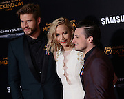 JENNIFER LAWRENCE, LIAM HEMSWORTH and JOSH HUTCHERSON  at the premiere of 'The Hunger Games: Mockingjay - Part 2' held at the Micorsoft theatre.<br /> ©Exclusivepix Media