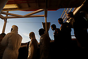 Rescued migrants wait to disembark from the Malta-based NGO Migrant Offshore Aid Station (MOAS) ship Phoenix in Pozzallo on the island of Sicily, Italy, April 6, 2017.   REUTERS/Darrin Zammit Lupi