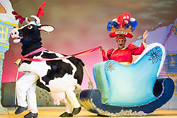 Hackney Empire Theatre, London, November 25th 2015.  Hackney Empire presents Jack and the Beanstalk as their 2015 Christmas pantomime. London's most famous panto will star Hackney Empire's own Olivier nominated dame Clive Rowe as Dame Daisy Trott, Olivier Award-nominated Bodyguard actress Debbie Kurup as Jack and Hackney Panto favourite Kat B as Snowman. Written and directed by Creative Director Susie McKenna, with music by Steven Edis. PICTURED: Clive Rowe as Dame Daisy Trott and Cow.