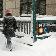 Woman Walking by a Subway Stop in Manhattan during a Snowstorm in 2006