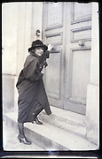 young adult woman by front door early 1900s