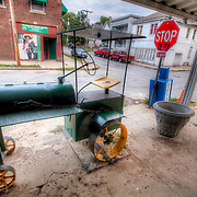 Metal toy tractor on the sidewalk in front of Ortega's Mexican Store at 27th and Belleview in Kansas City's Westside.