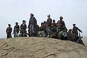 Northern Alliance forces wait for defecting Taliban to arrive close to the outskirts of the northern city of Kunduz.