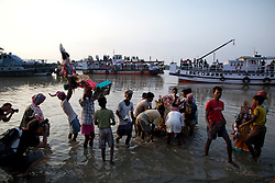 © under license to London News Pictures.  17/10/2010 ©London News Pictures. 17/10/2010. Devotees carry an idol of Hindu goddess Durga before immersing it in the river Ganges on the last day of the Durga Puja festival on October 17, 2010 in Kolkata, India. The festival is the biggest of the year in the Indian state of Bengal and celebrates the worship of the Hindu Goddess Durga, who in Hindu Mythology is celebrated as the Goddess of power and the victor of good over evil.