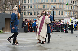 © London News Pictures. 03/04/15. London, UK. Jesus is captured during the performance of The Passion of Jesus, Trafalgar Square, central London on Good Friday. Photo credit: Laura Lean/LNP