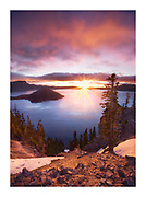 Beautiful pink sunrise from the rim of Crater Lake with Wizard Island visible