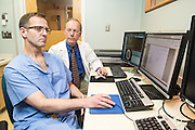 Neurosurgeon Steven P. Kiefer MD, left, and Radiation Oncologist Alan Beckman, MD, photographed Thursday, May 21, 2015 at Baptist Health in Lexington, Ky. (Photo by Brian Bohannon/Videobred for Baptist Health)