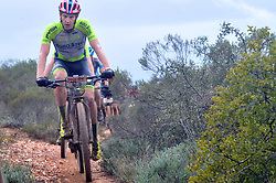 WORCESTER, SOUTH AFRICA - MARCH 21: Matthys Beukes leads riders along single track during stage three's 122km from Robertson to Worcester on March 21, 2018 in Cape Town, South Africa. Mountain bikers from across South Africa and internationally gather to compete in the 2018 ABSA Cape Epic, racing 8 days and 658km across the Western Cape with an accumulated 13 530m of climbing ascent, often referred to as the 'untamed race' the Cape Epic is said to be the toughest mountain bike event in the world. (Photo by Dino Lloyd)