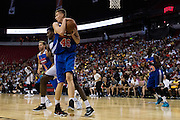 Kristaps Porzingis #46 of the New York Knicks grabs a rebound against the San Antonio Spurs during an NBA Summer League game in Las Vegas, Nevada on July 11, 2015. (Cooper Neill for The New York Times)