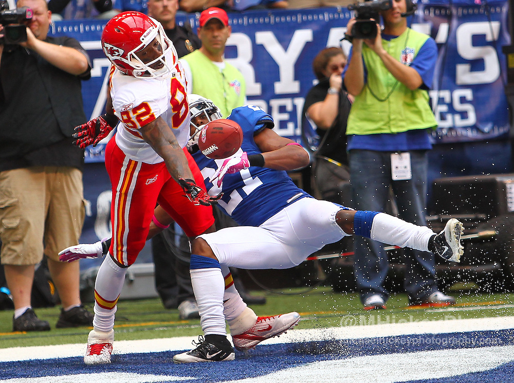 Oct. 09, 2011; Indianapolis, IN, USA; Kansas City Chiefs wide receiver Dwayne Bowe (82) juggles a touchdown reception in the end zone as Indianapolis Colts cornerback Jacob Lacey (27) defends at Lucas Oil Stadium. Mandatory credit: Michael Hickey-US PRESSWIRE
