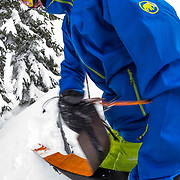 Tyler Hatcher pulls his skins up for another run in the Cascade backcountry.