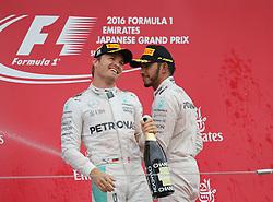 October 9, 2016 - Suzuka, Japan - Motorsports: FIA Formula One World Championship 2016, Grand Prix of Japan, .#6 Nico Rosberg (GER, Mercedes AMG Petronas Formula One Team), #44 Lewis Hamilton (GBR, Mercedes AMG Petronas Formula One Team) (Credit Image: © Hoch Zwei via ZUMA Wire)
