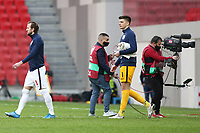 TIRANA, ALBANIA - MARCH 28: Harry Kane [left] and Nick Pope [right] lead out England before the FIFA World Cup 2022 Qatar qualifying match between Albania and England at the Qemal Stafa Stadium on March 28, 2021 in Tirana, Albania. Sporting stadiums around Europe remain under strict restrictions due to the Coronavirus Pandemic as Government social distancing laws prohibit fans inside venues resulting in games being played behind closed doors (Photo by MB Media)